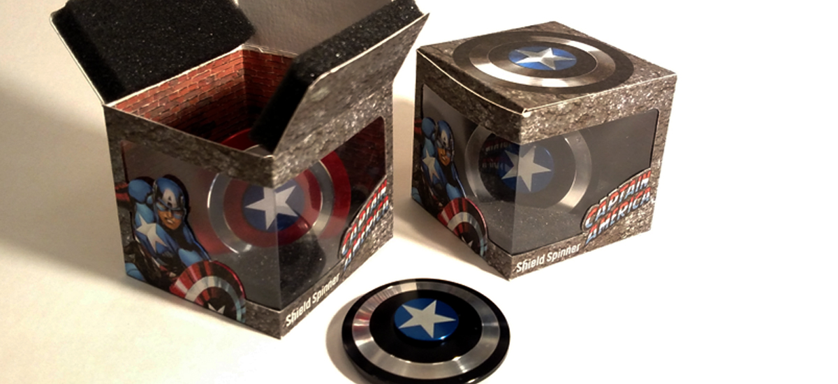 Captain America Fidget Spinner Package Redesign - Augustana College Graphic Design 325 Course, Design was printed, cutout and assembled so that the box base could be removed to allow the spinner to sit freely on a desk. - Adobe Illustrator CS4-CS6 - 2017